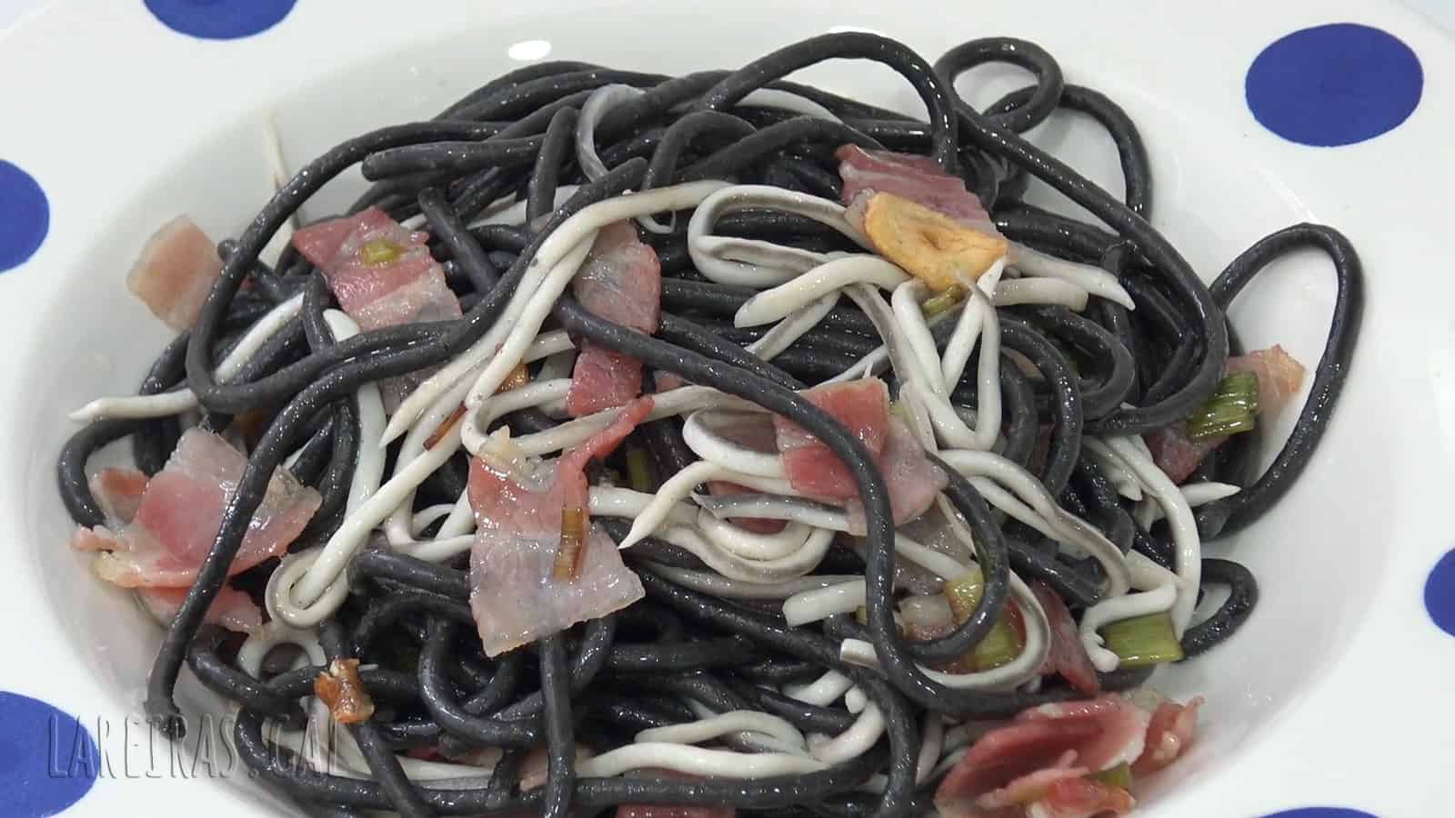 Sautéed black spaghetti with bacon and gulas